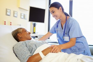 stock-photo-nurse-talking-to-senior-woman-in-hospital-room-168812324